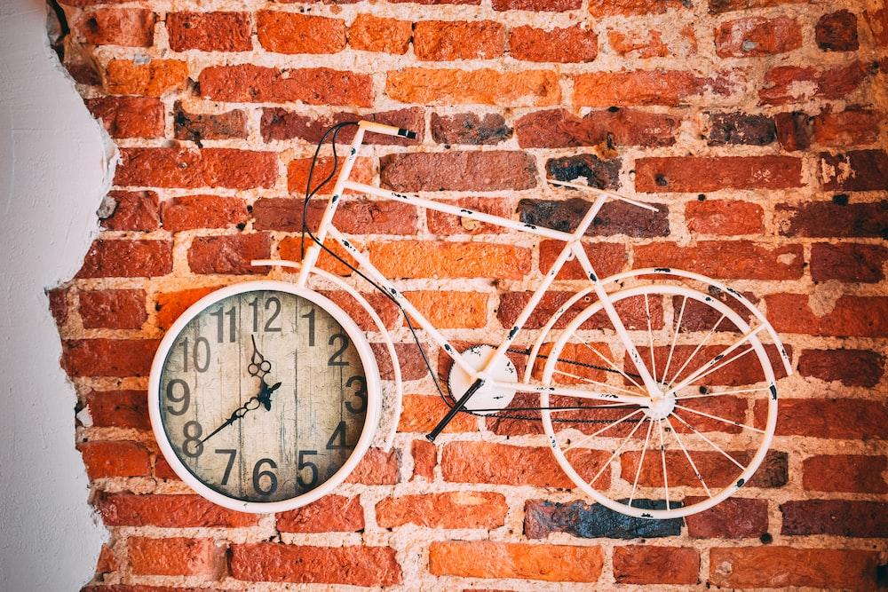 white bicycle analog wall clock