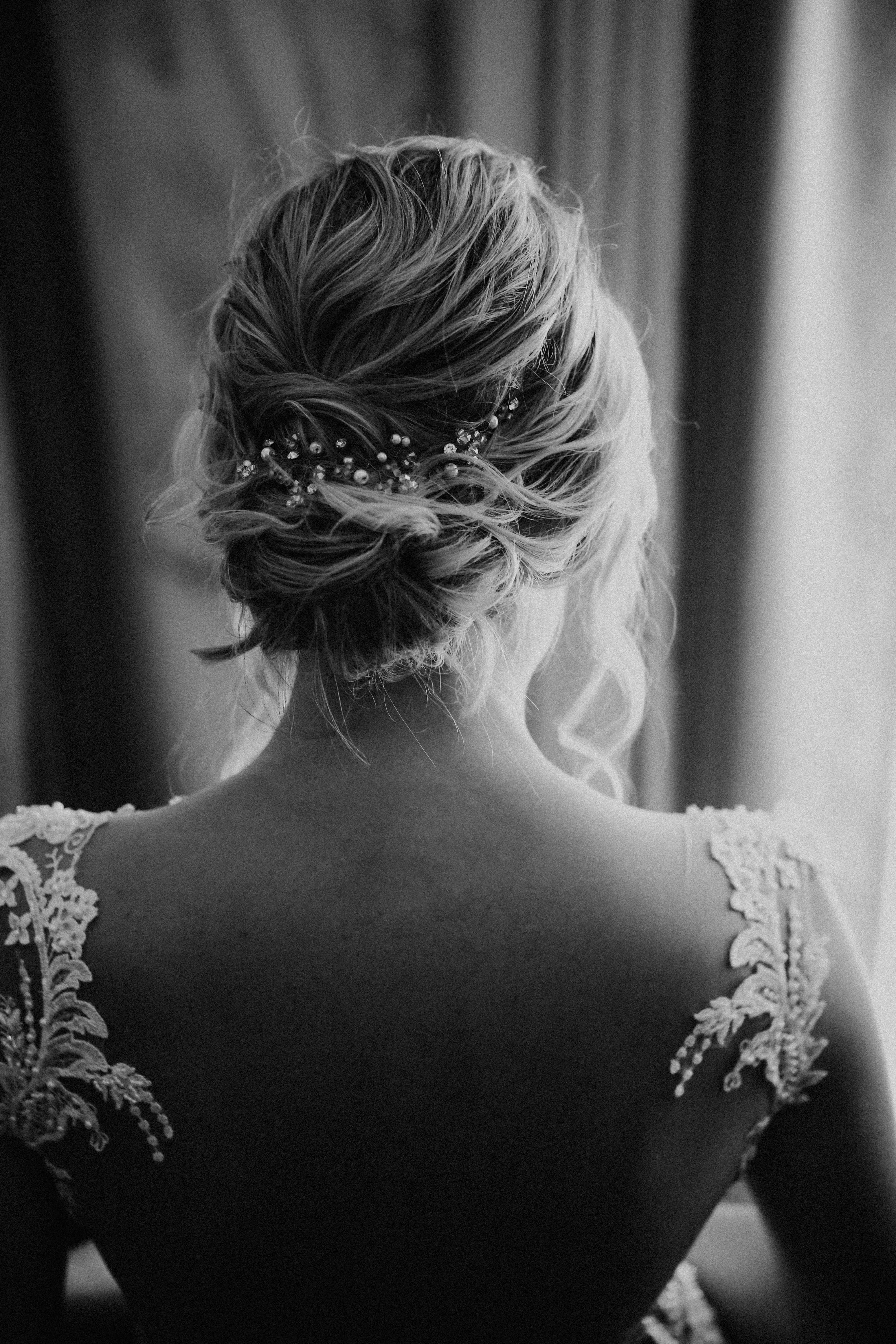 grayscale photography of woman in wedding dress