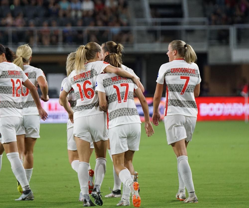 female soccer team on green grass
