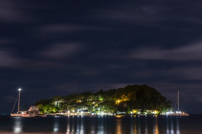 aerial photography of island at night time saint vincent and the grenadines teams background