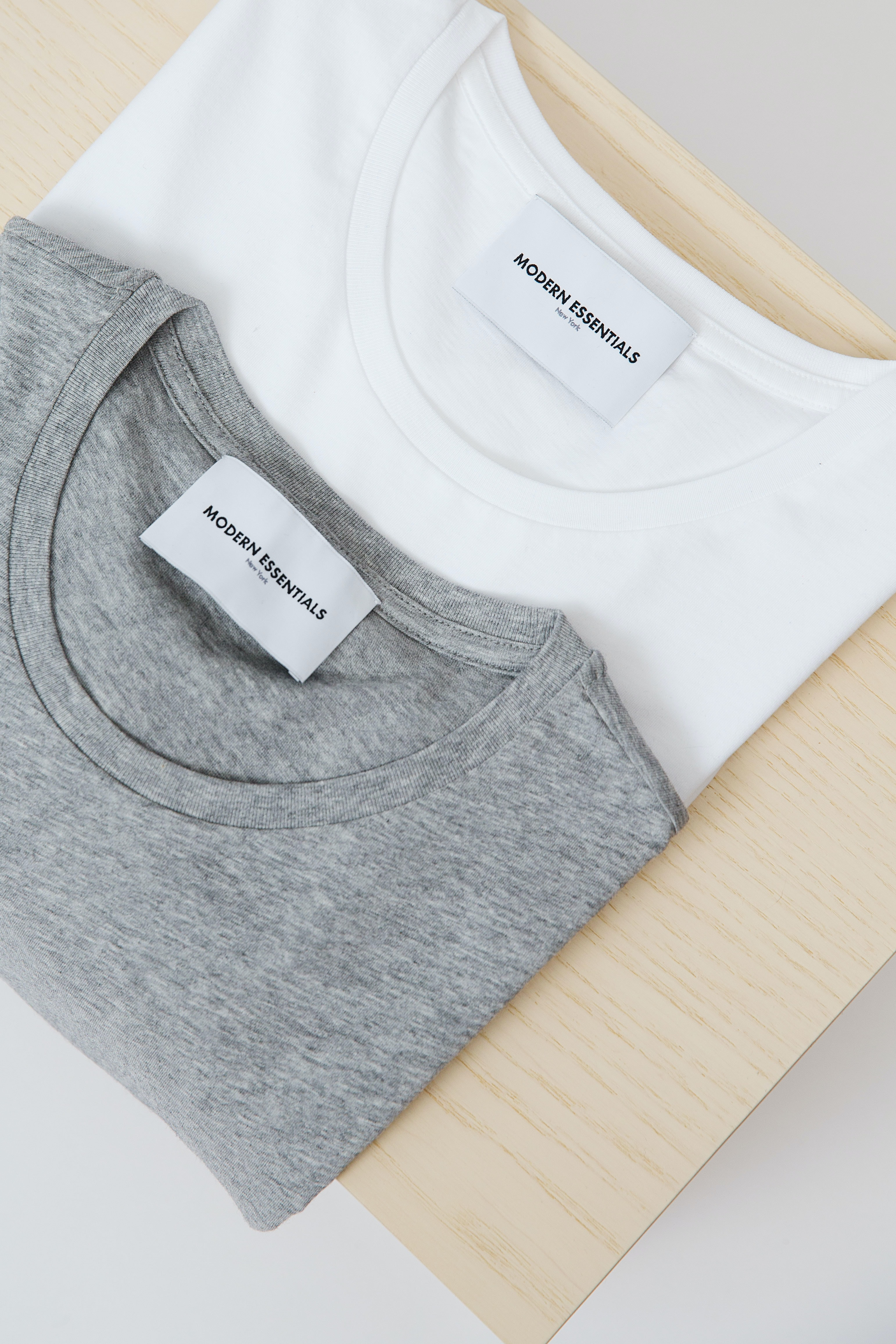 white and gray crew-neck tops