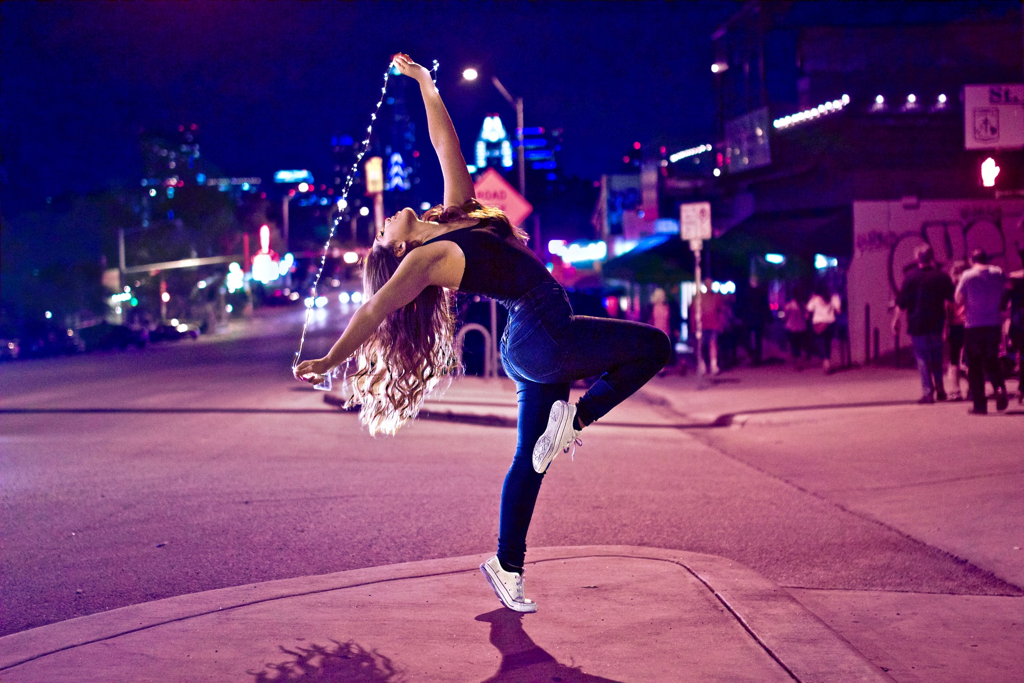 a girl dancing on the road