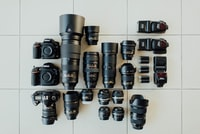 flat lay photography of DSLR camera set