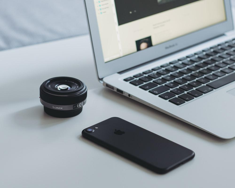 black iPhone 7 and MacBook Air