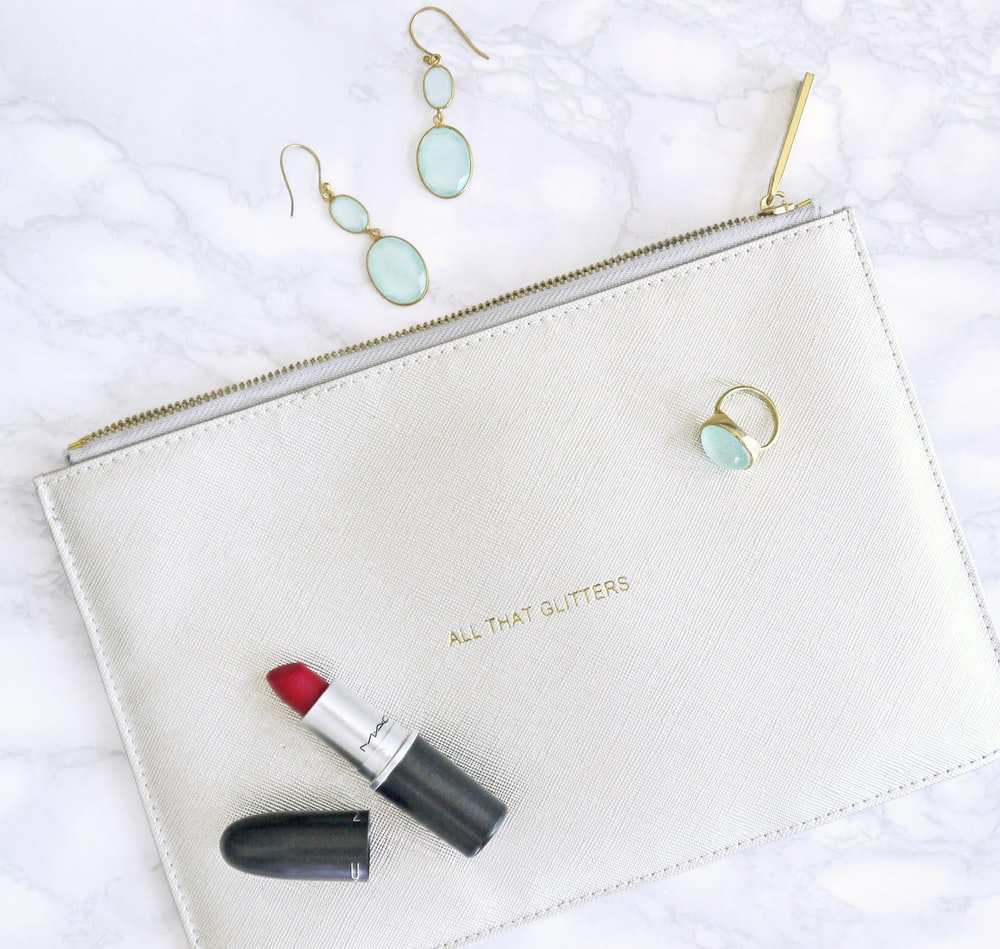 red lipstick, white leather bag, and earrings