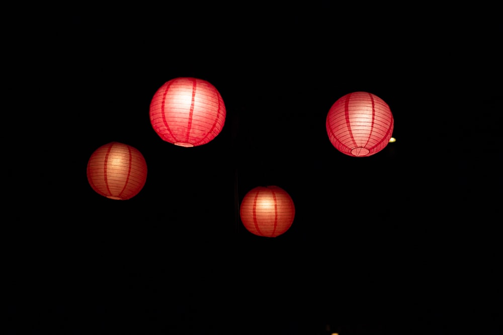 four red floating sky lanterns