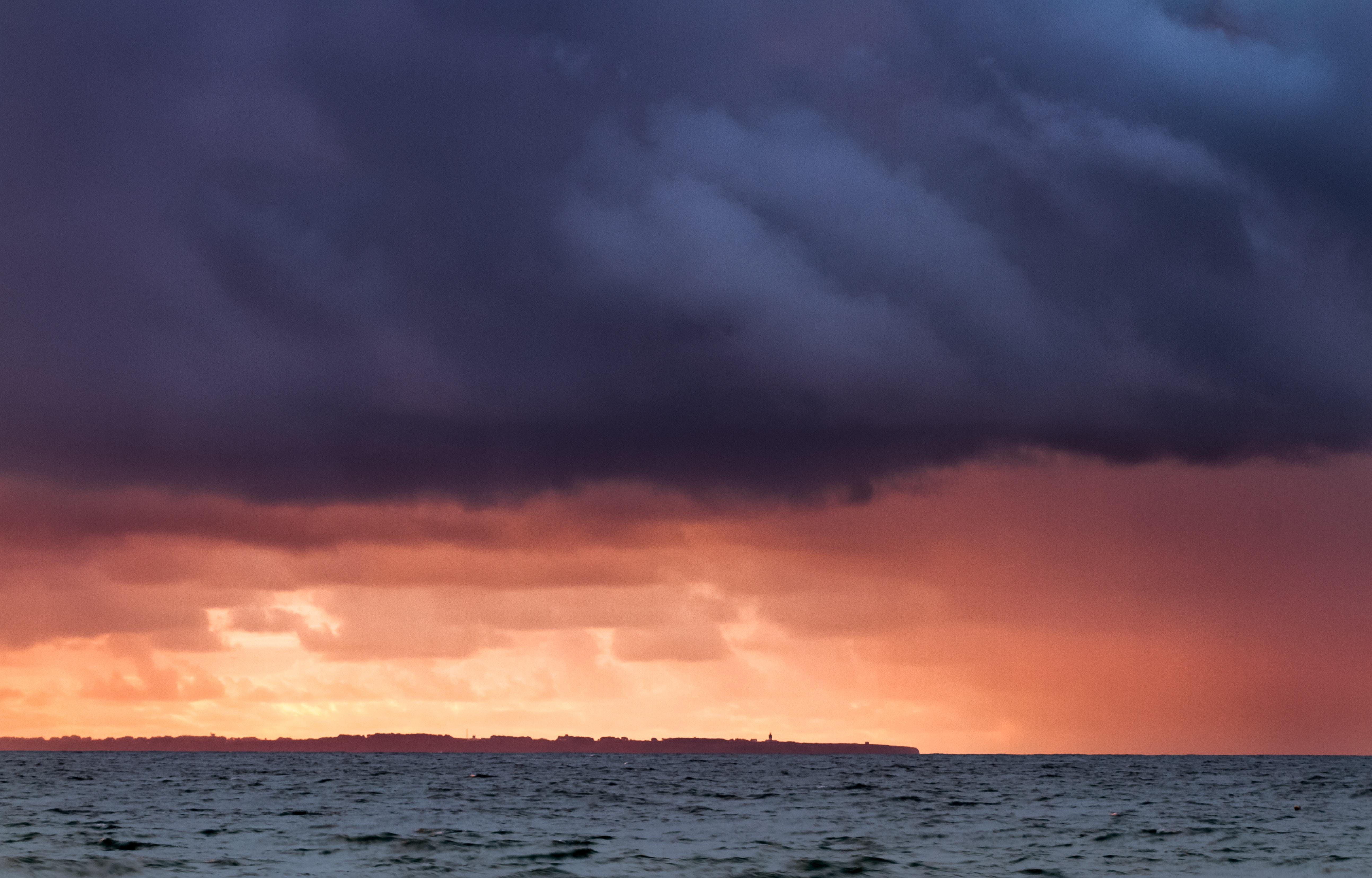 gray nimbus clouds above sea