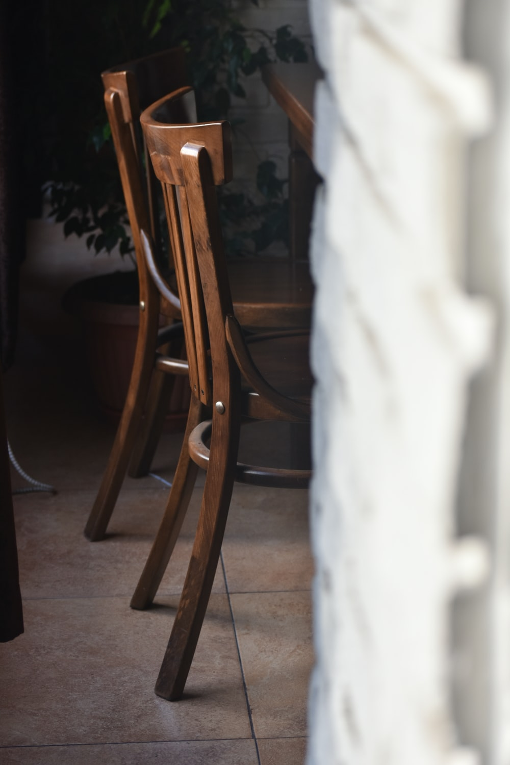 brown wooden chairs in front brown wooden table