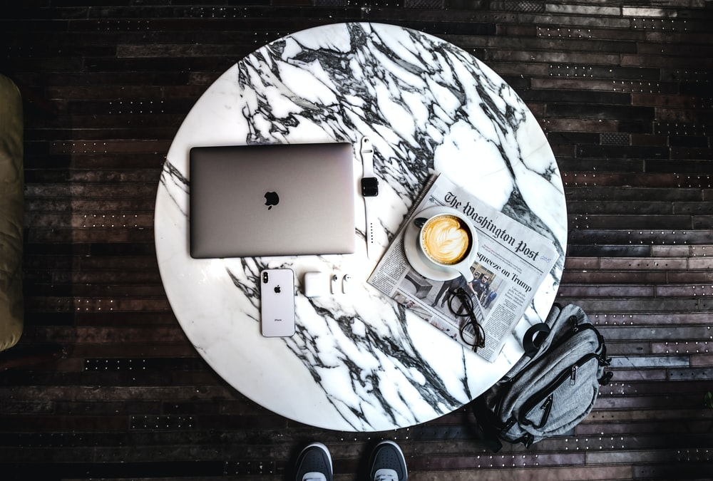 silver ipad on brown wooden table