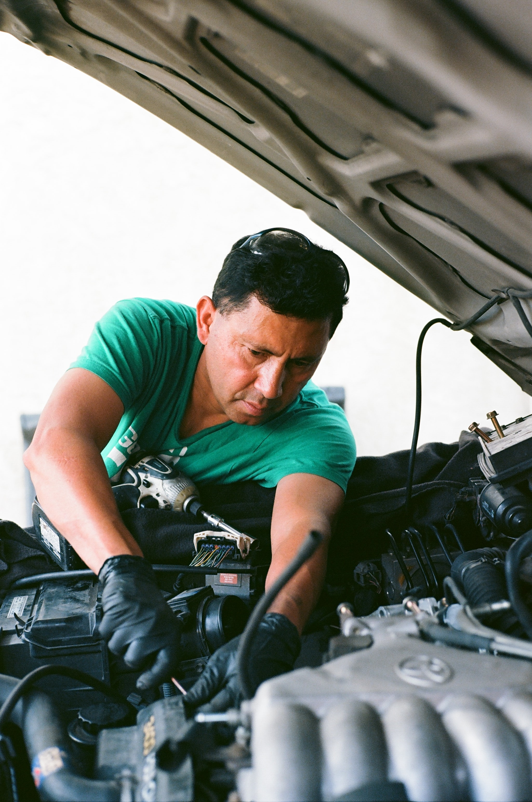 man repairing vehicle engine
