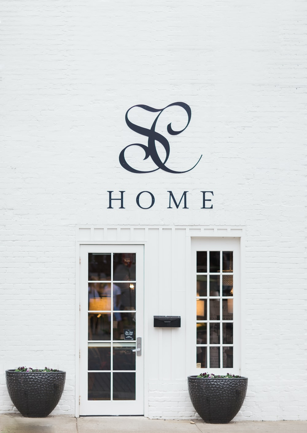 Home storefront beside white door