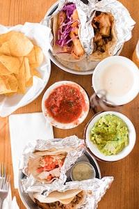 nachos with guacamole and tacos