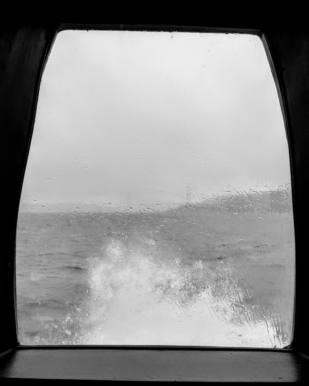 sea waves splashing trough boat window