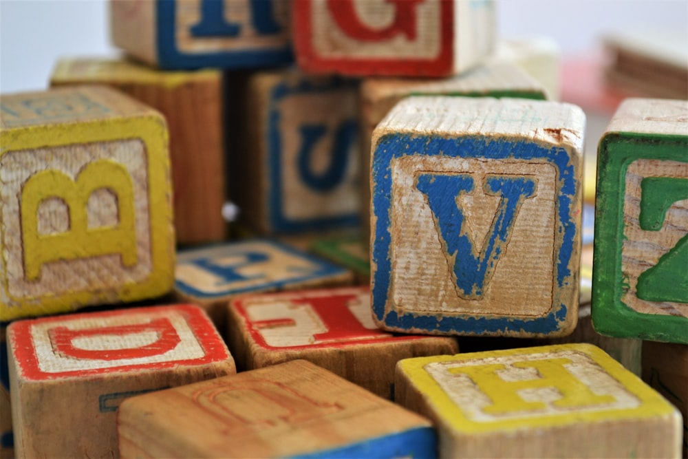 assorted-color alphabet cube toy lot