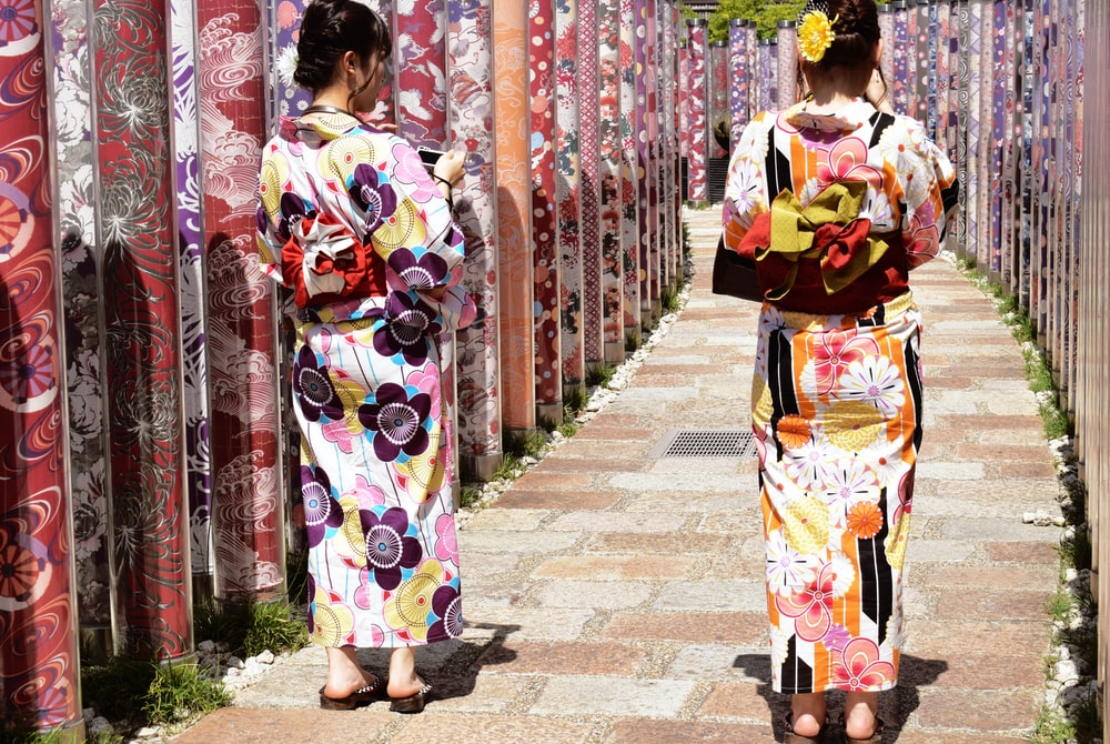 two women wearing floral traditional dresses