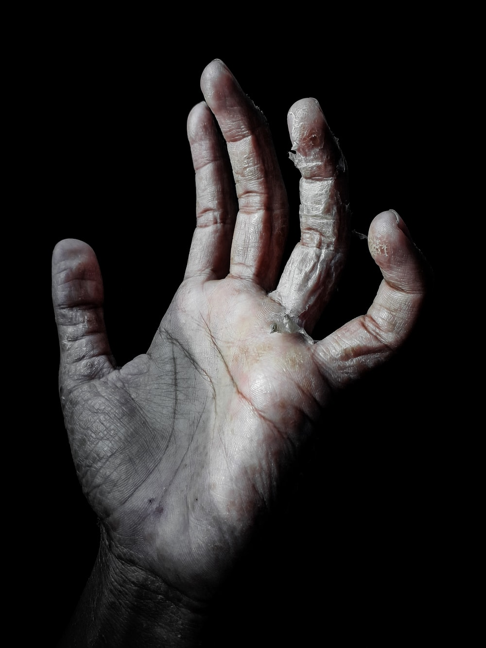 person raising left human palm