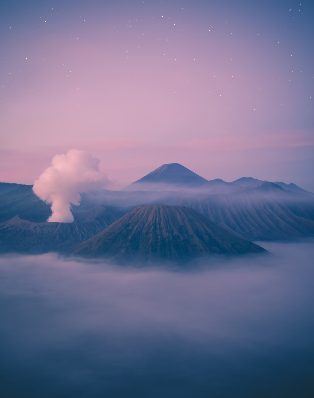 mountain surrounded by clouds