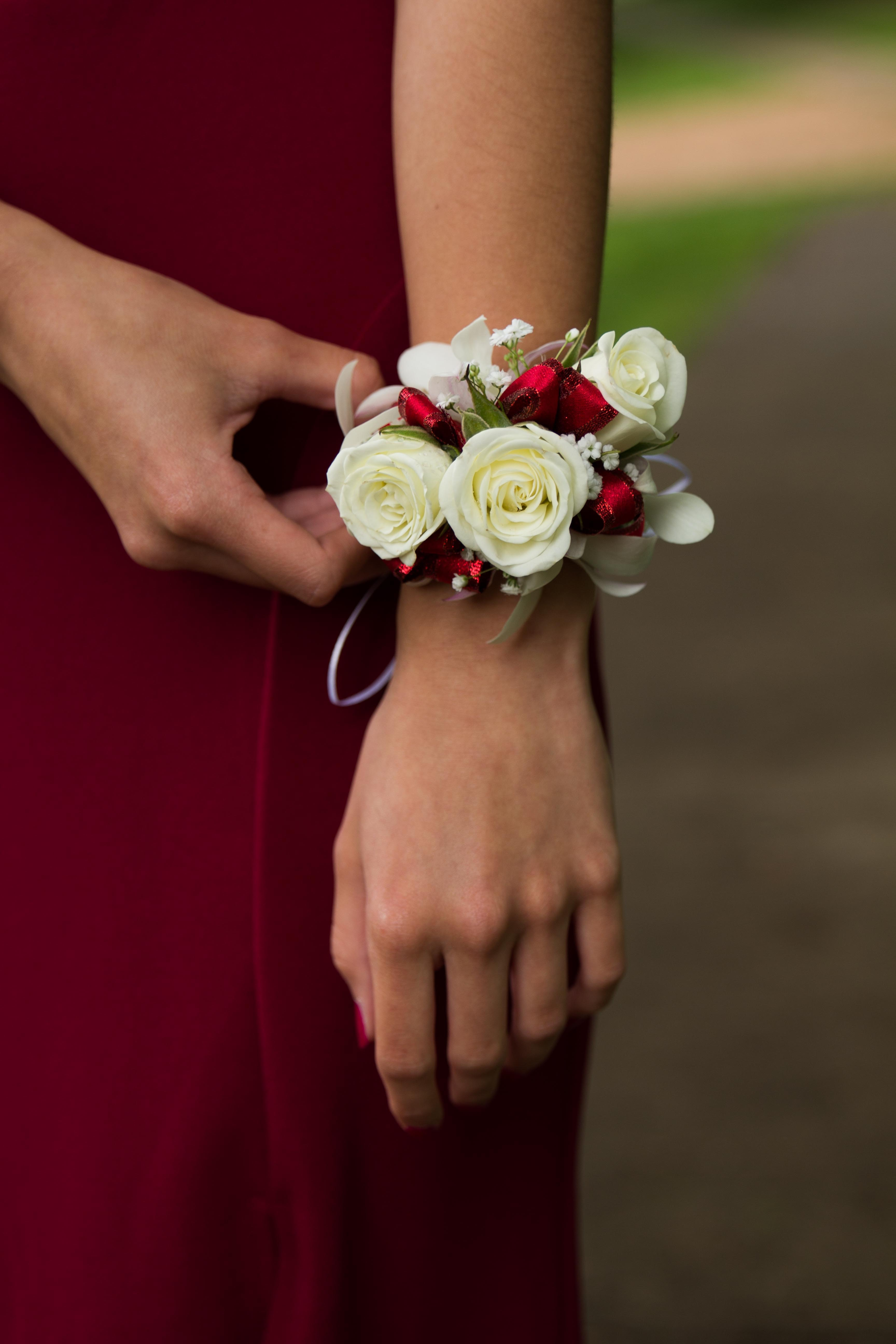 woman wearing bridal flower bracelet