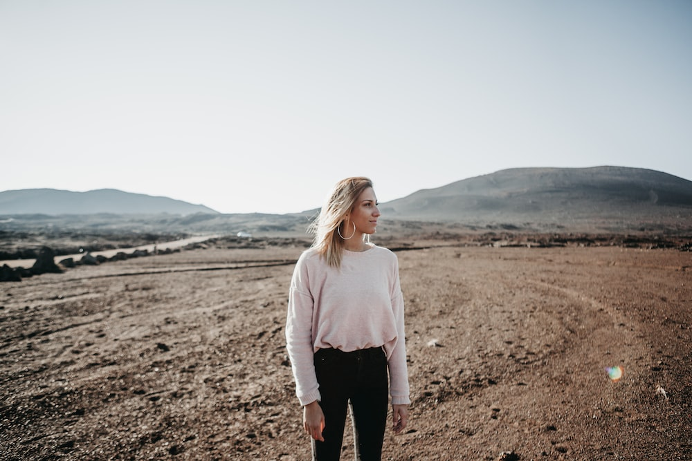 women's white crew-neck long-sleeved shirt, black pants, and silver-colored hoop earrings