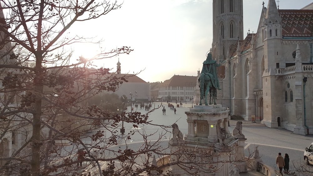 human statue and catherdral