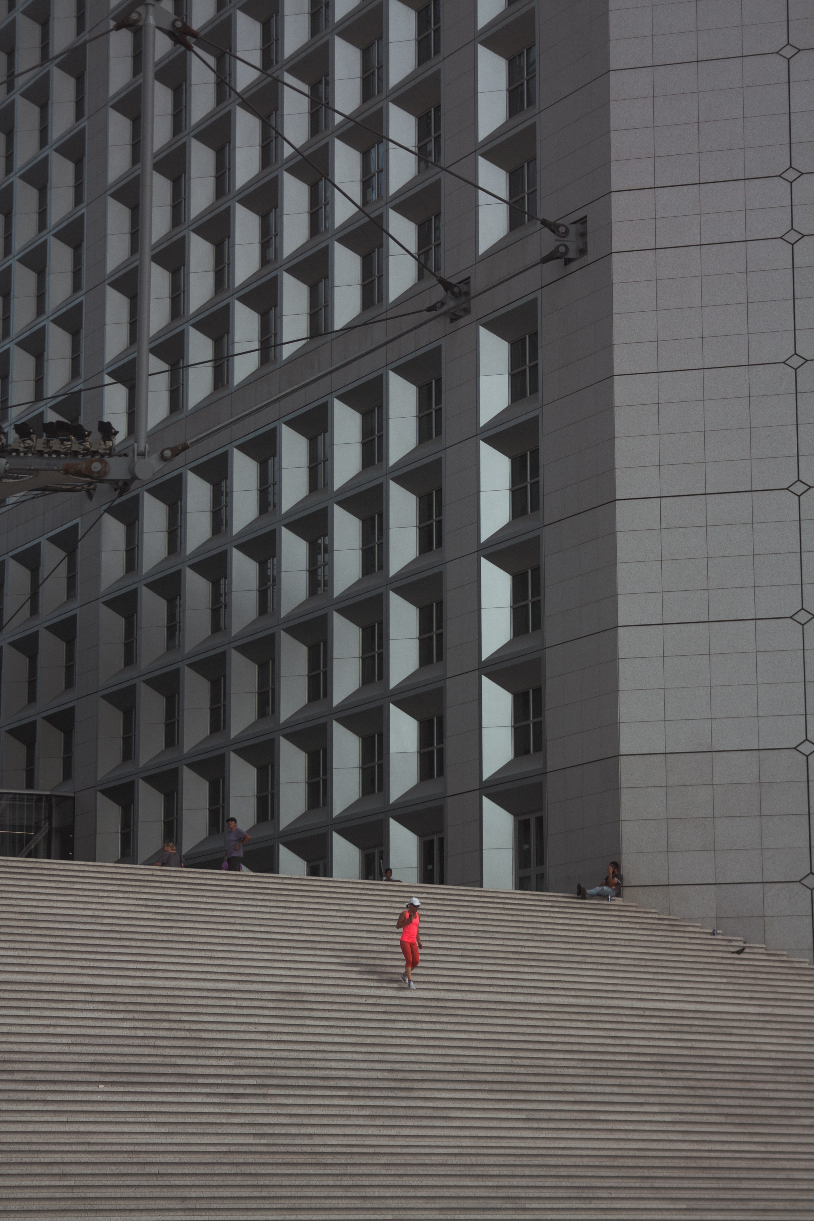 person walking downstairs near concrete building