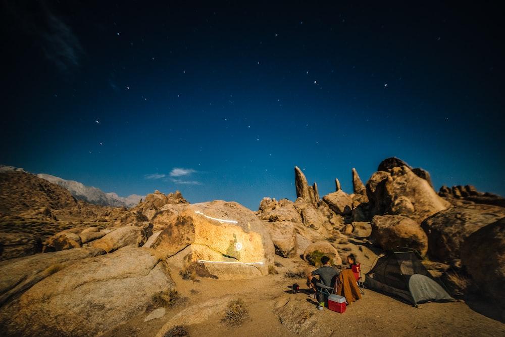man and woman camping