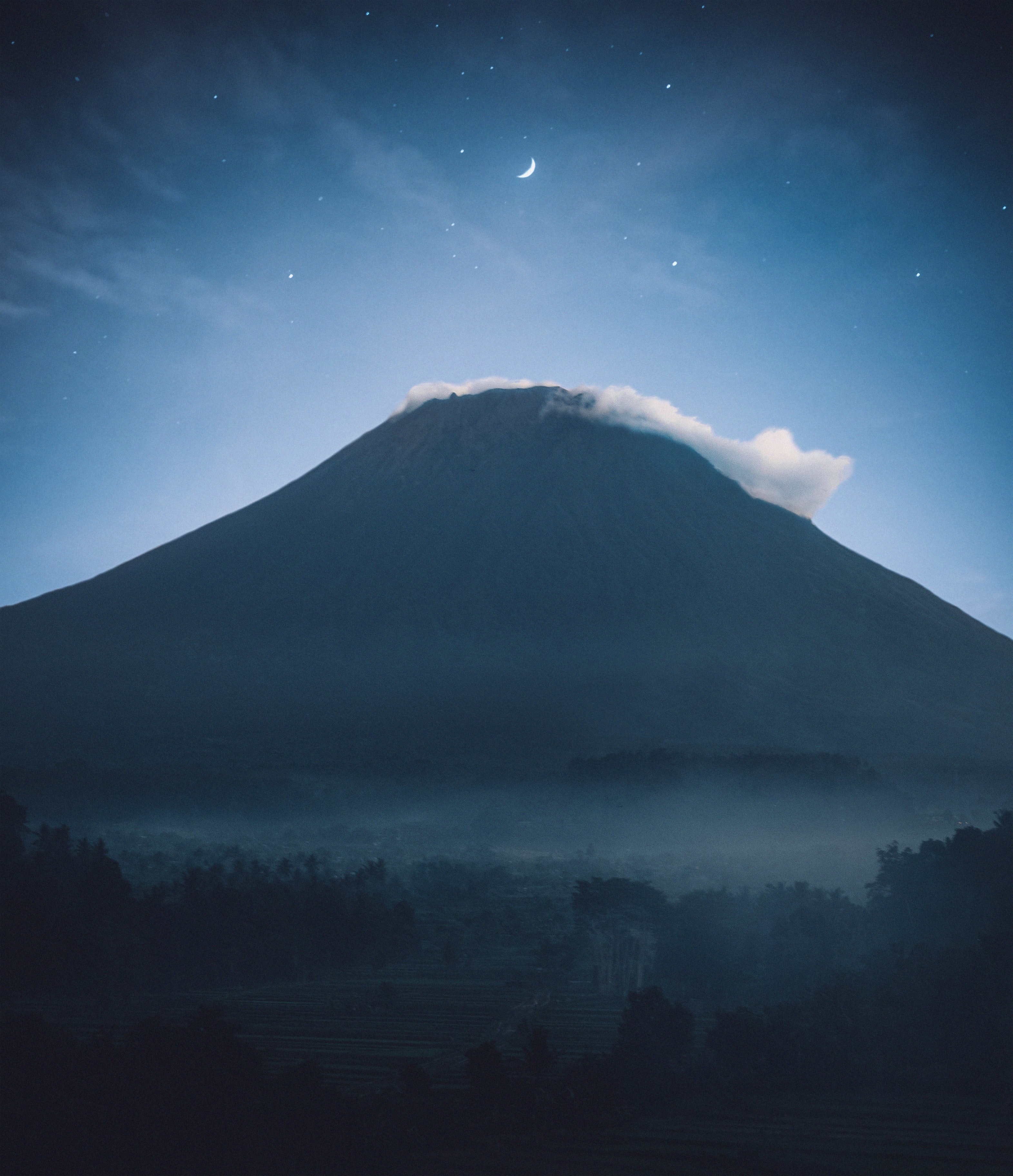 mountain covered by clouds