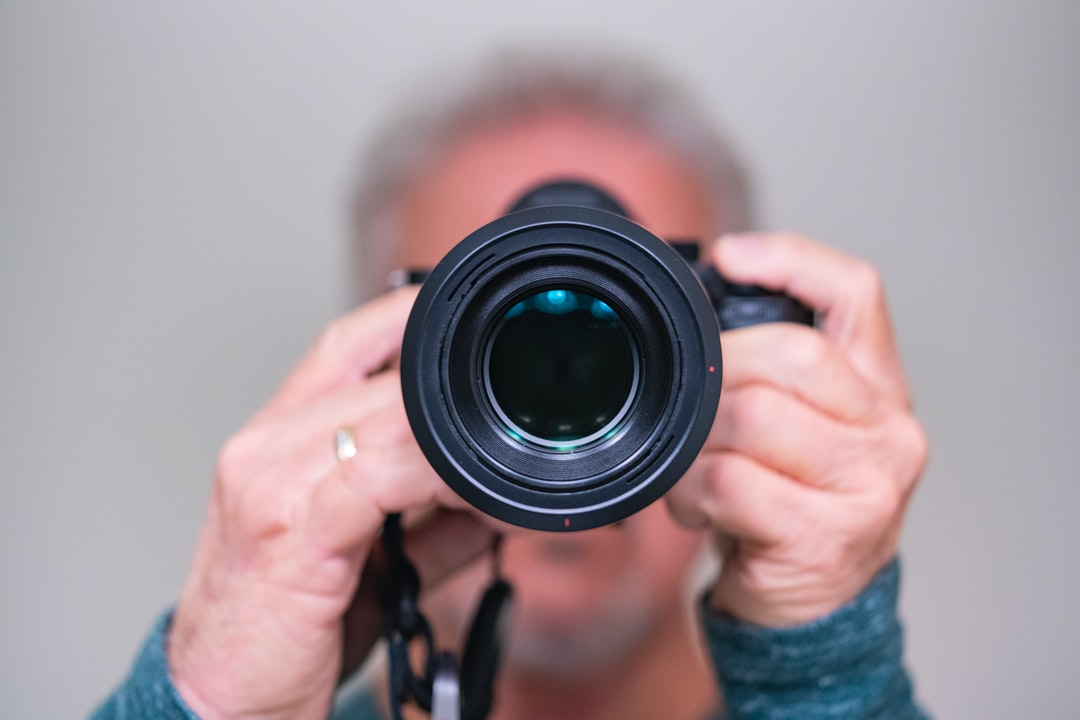 person holding digital camera
