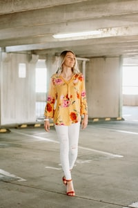 woman wearing yellow, green, red, and pink floral long-sleeved shirt