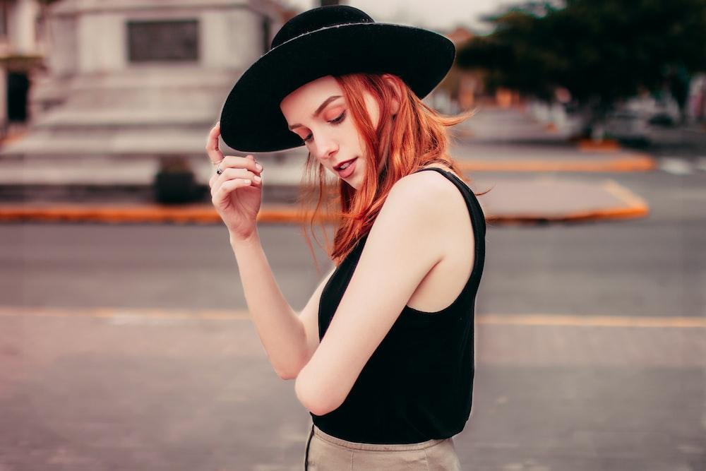 woman wearing black hat photo