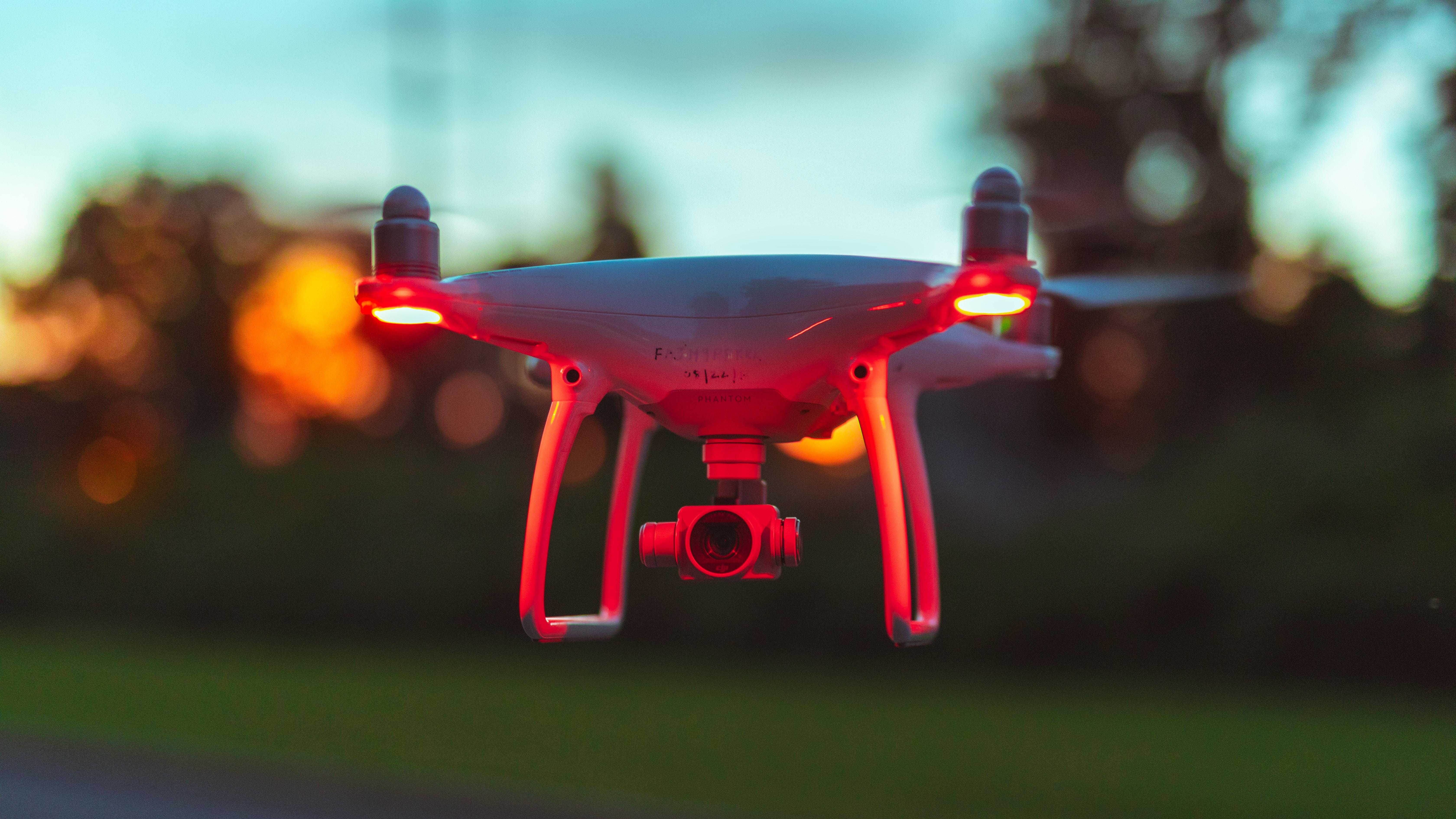 white quad copter camera drone