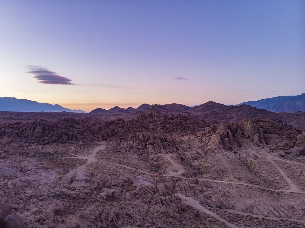 rocky mountain under dusk sky