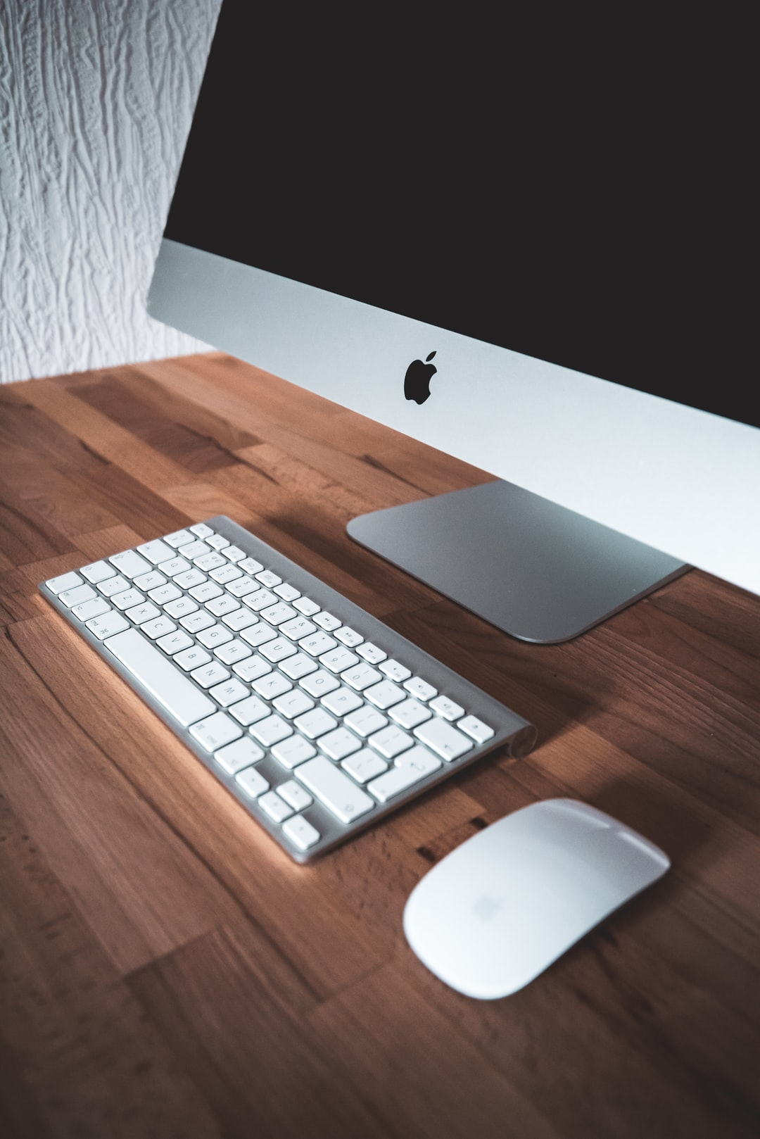 Apple iMac with keyboard and mouse on a clean desk