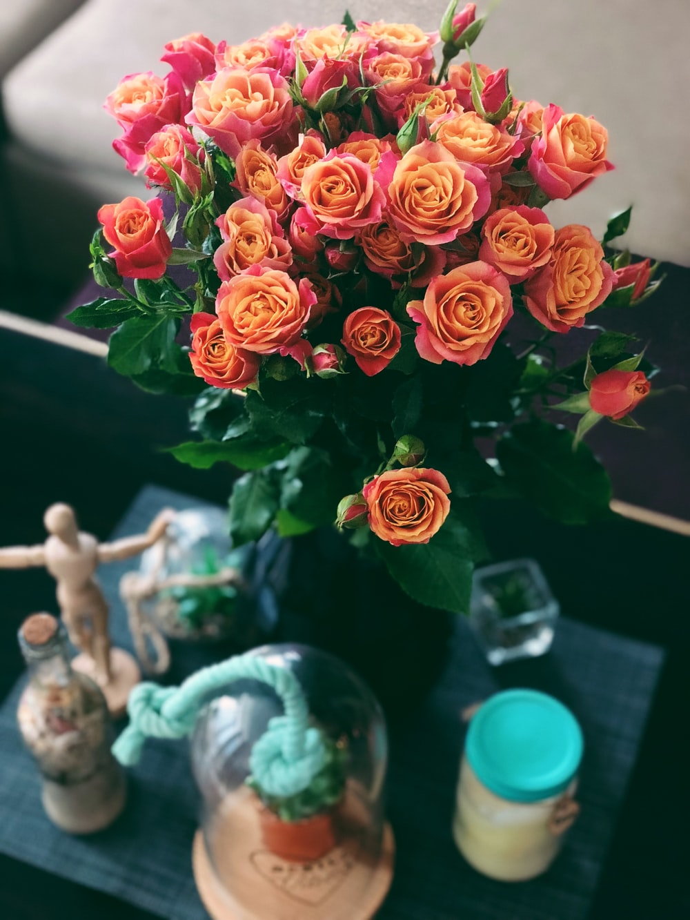 rose bouquet and clear glass jar