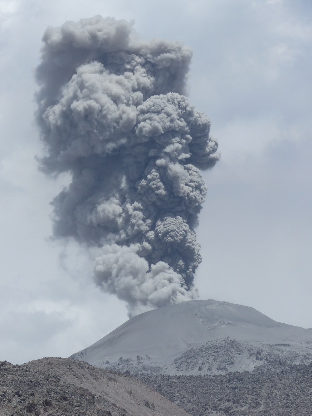 volcano under cloudy sky during daytime