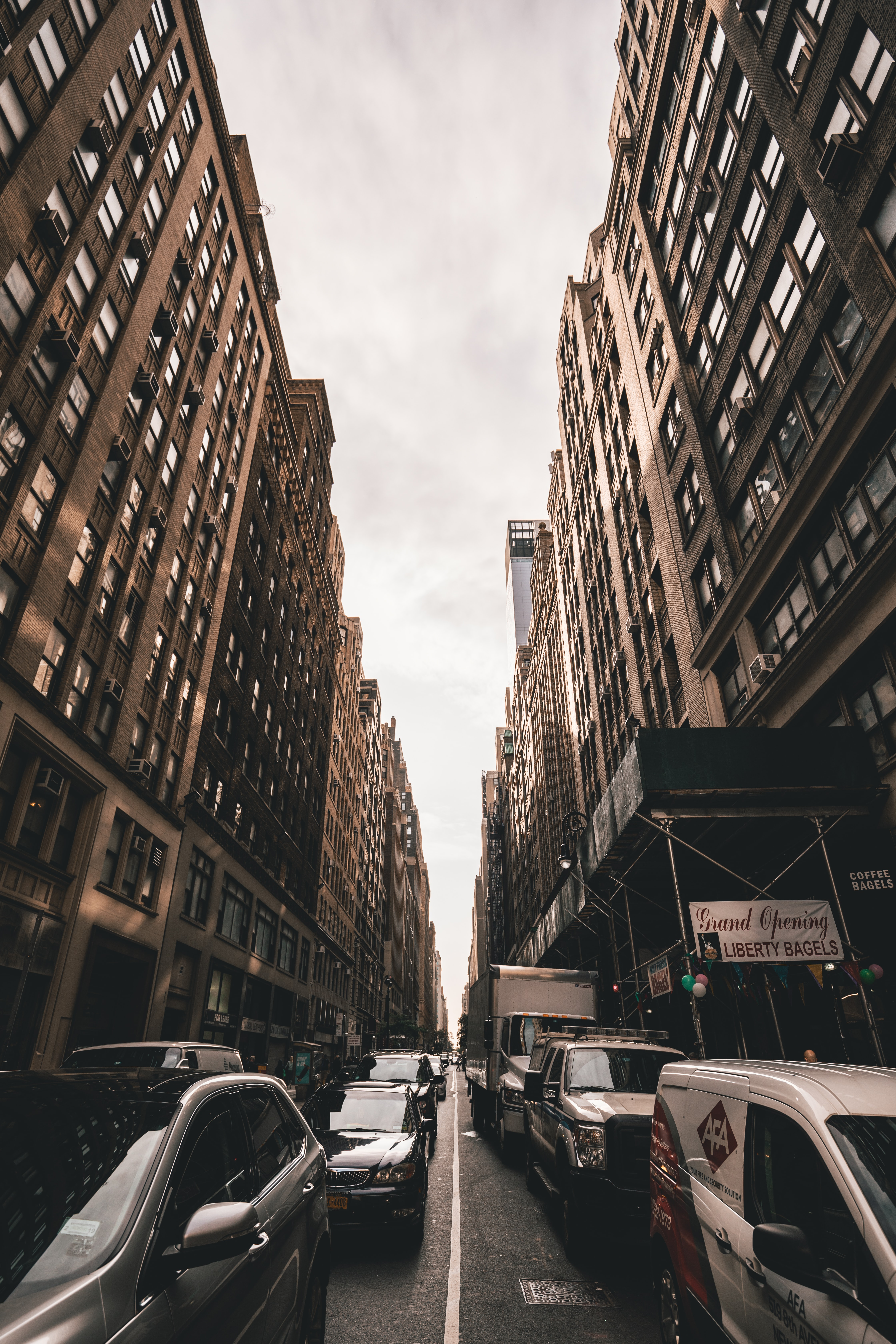 Low Angle Shot Photography Of Cars Between Buildings Photo Free Car Image On Unsplash