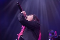 woman holding microphone while singing