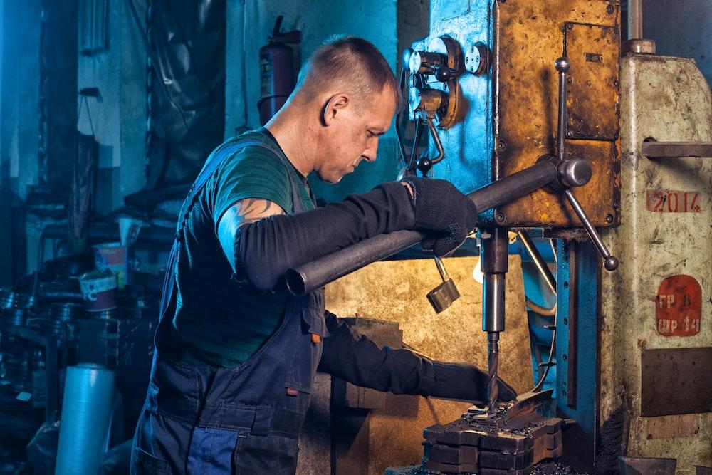 brass-colored manual drill press