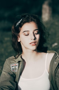 woman in white camisole and gray leather jacket portrait photography