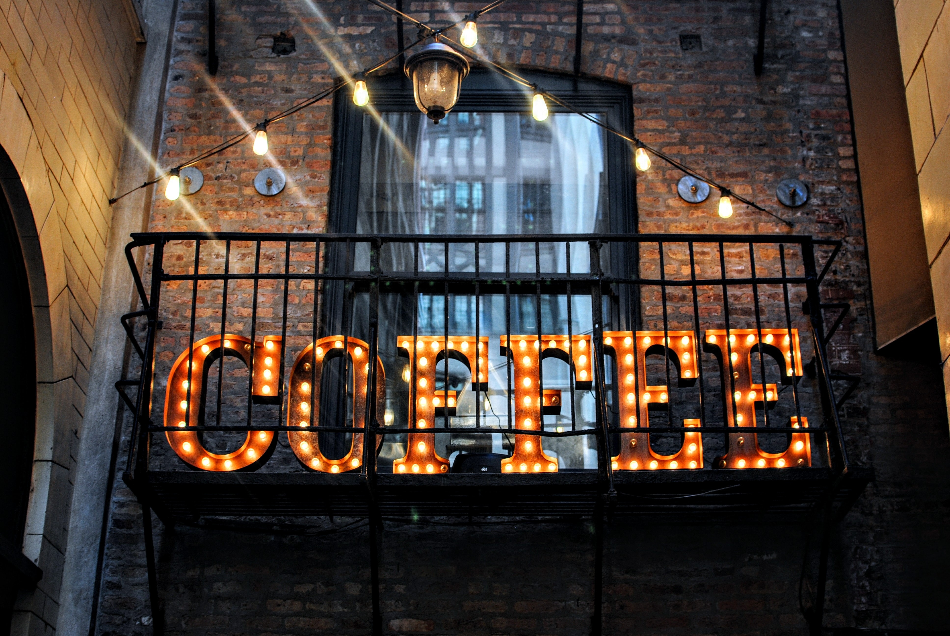 coffee marquee lights on wall