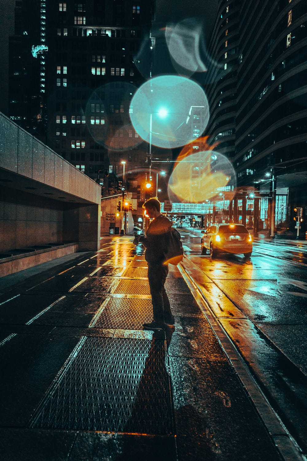 man standing in the street at night