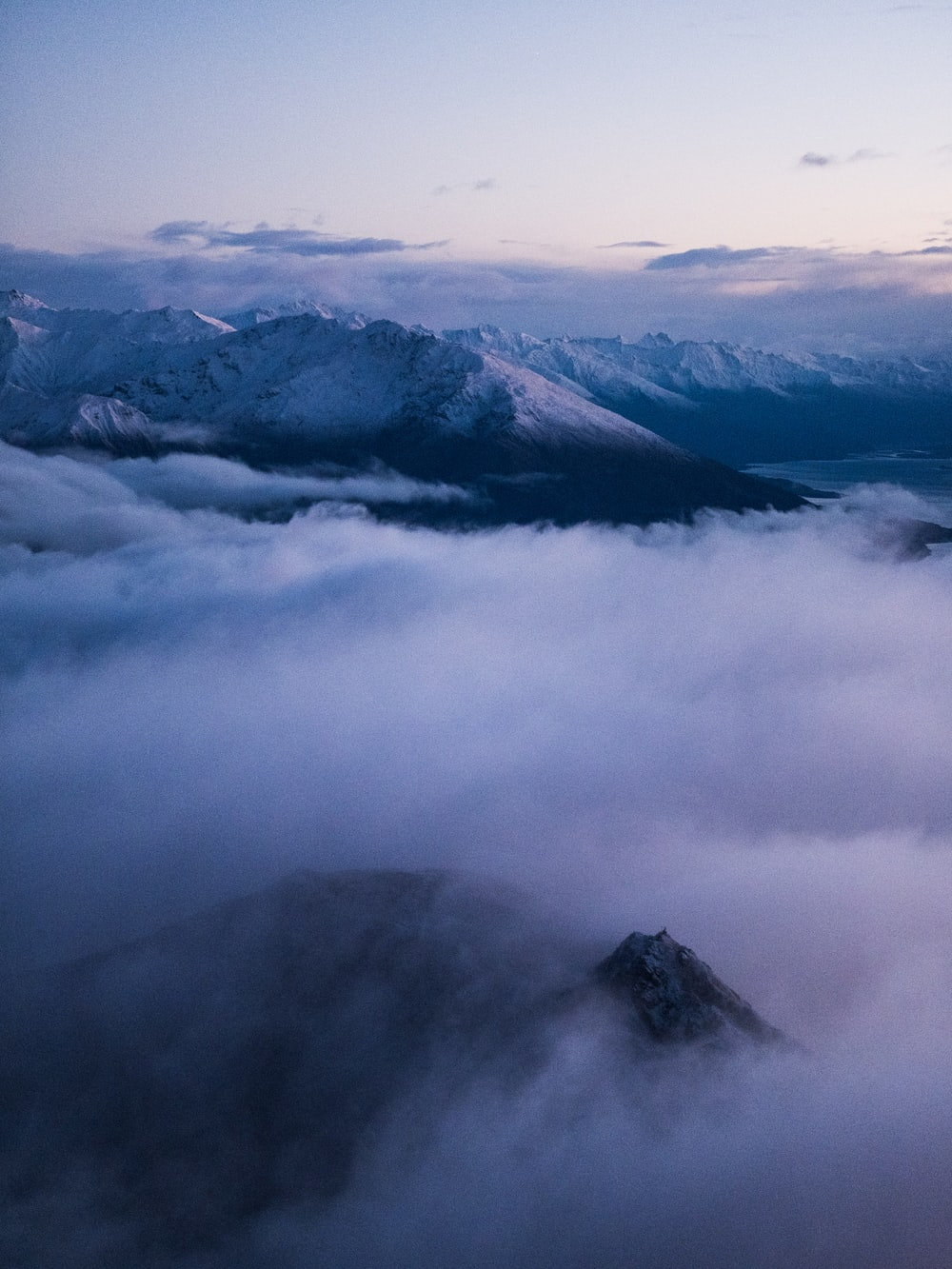 aerial photo of sea of clouds and mountain