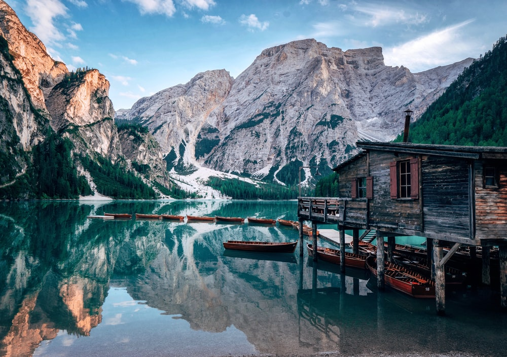 grey wooden cabin near body of water