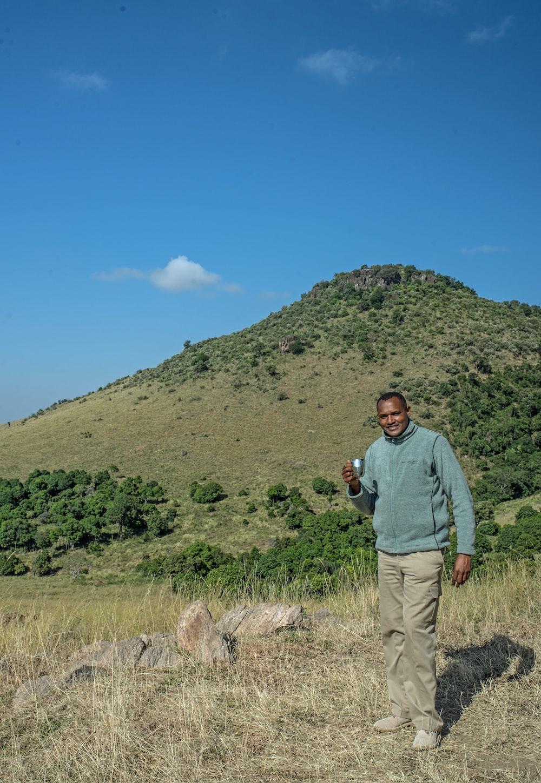 man standing on green field
