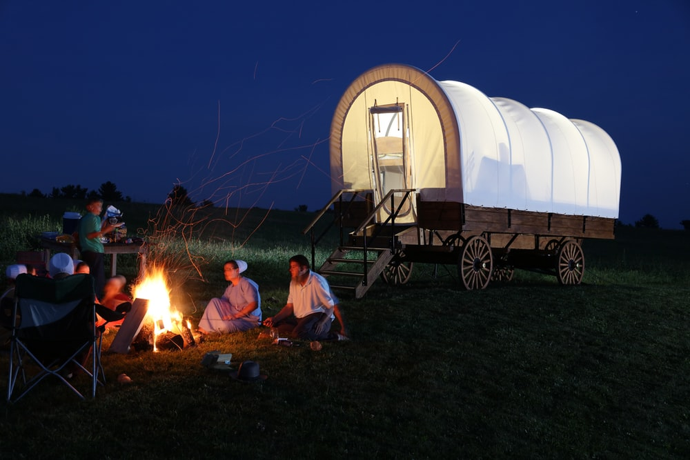 people outside of camper wagon