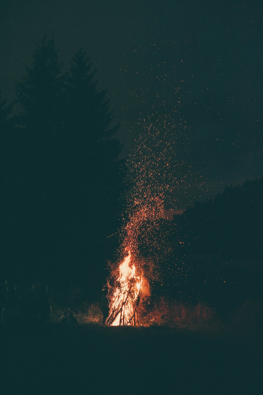 burning wood at night