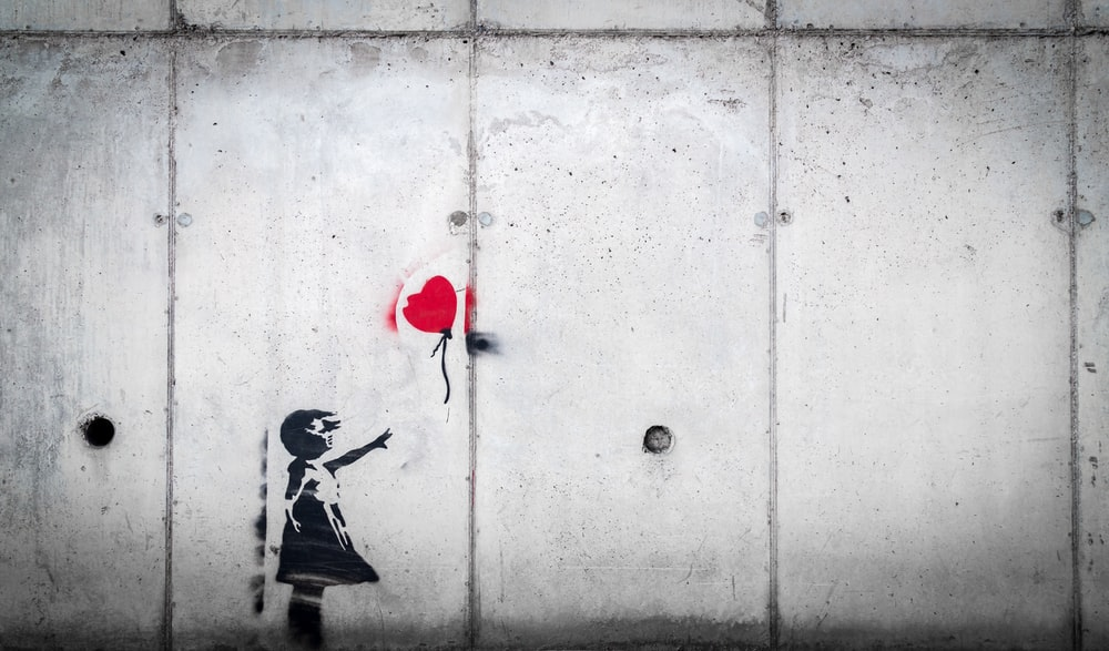 girl in black dress and red heart balloon wall decal