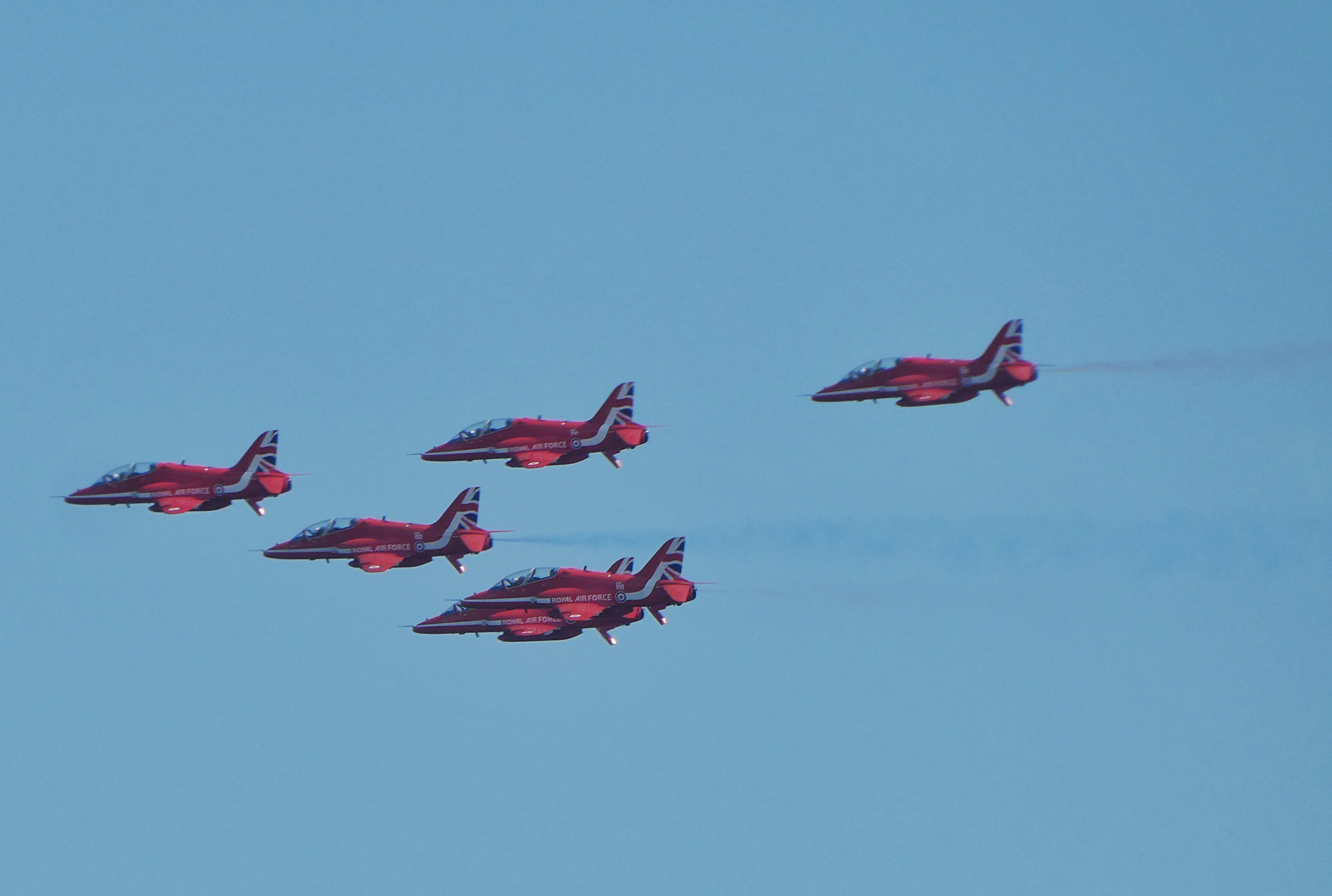 five red-and-black fighter jets
