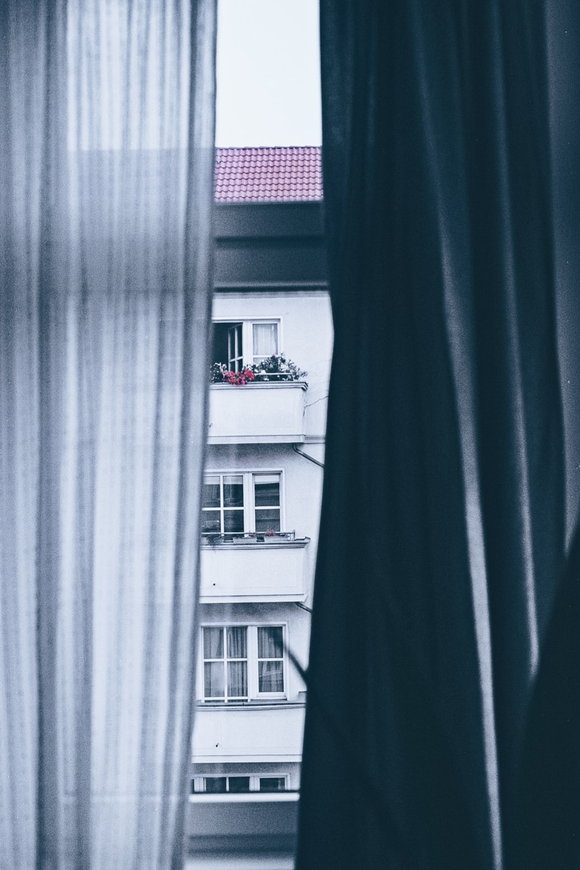 opened white window curtain