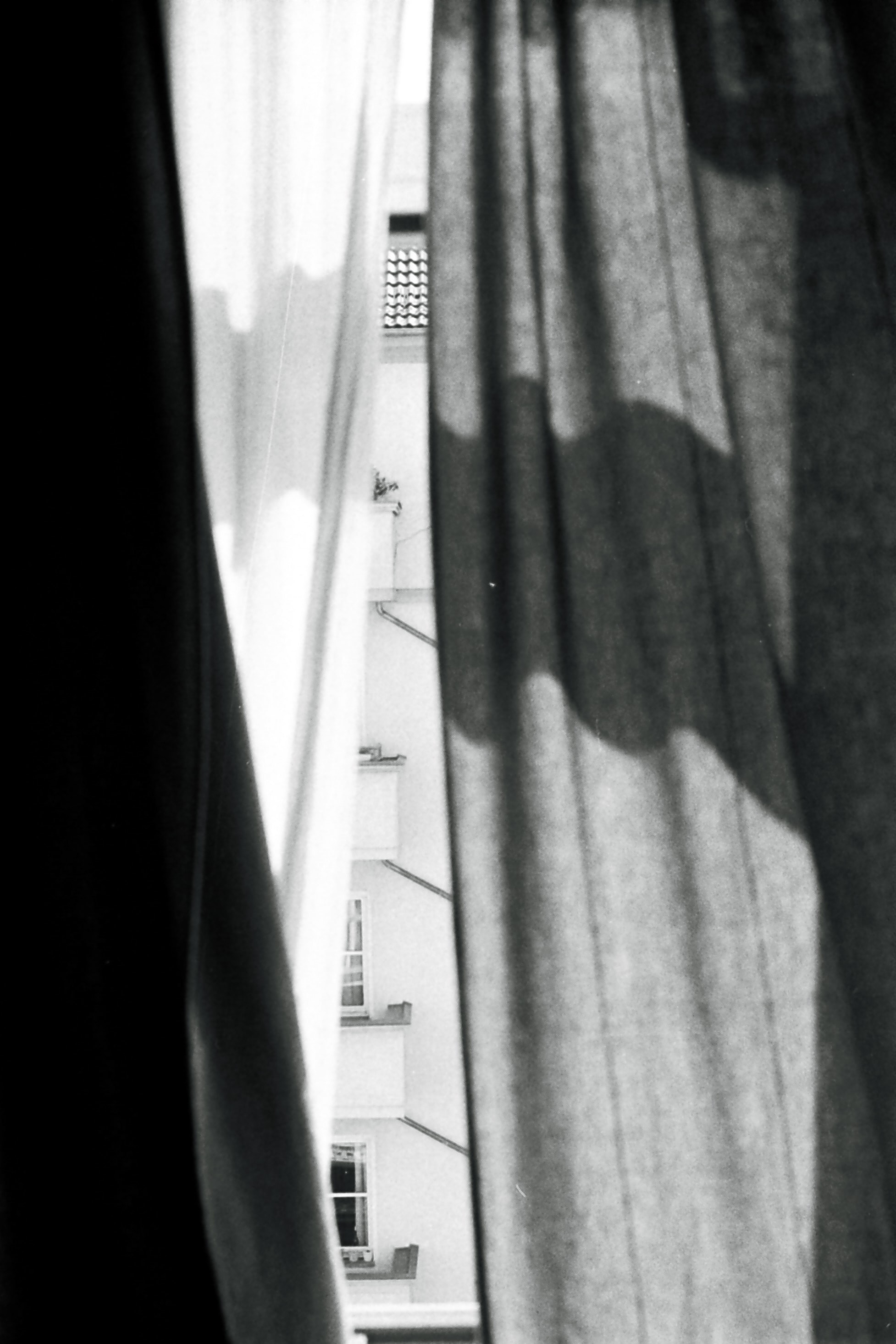 three white, gray, and black panel curtains